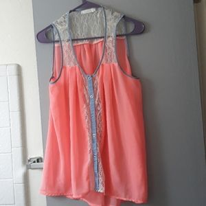 Lush sheer sleeveless blouse